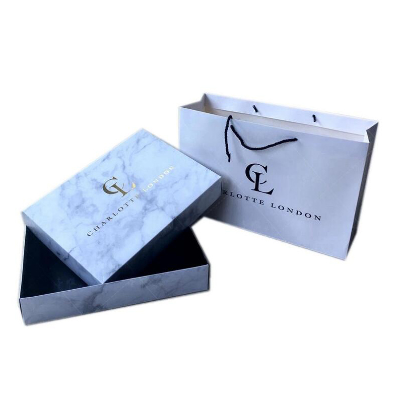Custom wholesale printed luxury paper shopping clothing packaging bag with logo