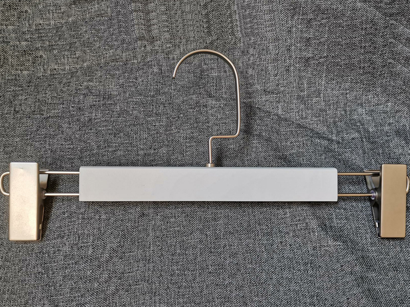 Wooden Pants Hanger With Two Clips On The End Of Hanger